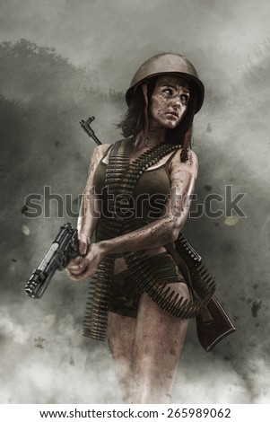 Young sexy army girl with a gun in the outdoor - stock photo
