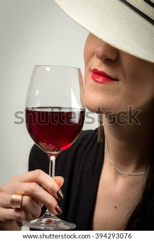 Young sexy, beautiful, attractive lady as model tasting red wine with elegance celebrating the possibility. - stock photo