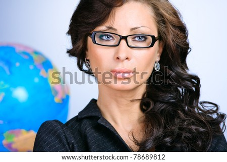 Young sexy beautiful business woman agains the globe - stock photo
