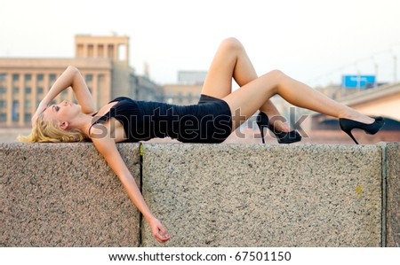 young sexy beautiful caucasian blond female lying outdoors. sensuality