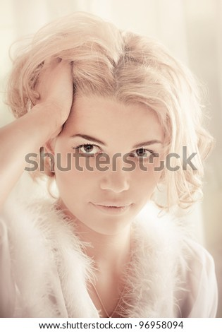 Young sexy beautiful woman on a bed - stock photo