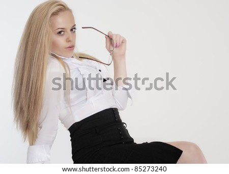 Young sexy blond woman in white shirt - stock photo
