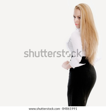 Young sexy blond woman in white shirt posing over white background. - stock photo