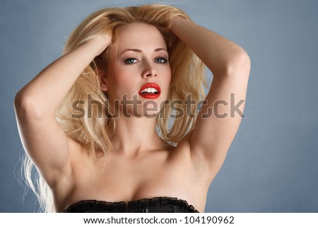 Young sexy blonde girl with bright red lips fashion portrait - stock photo