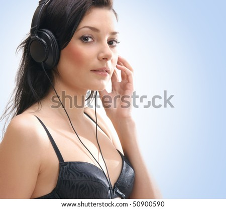 Young sexy brunette listening to the music
