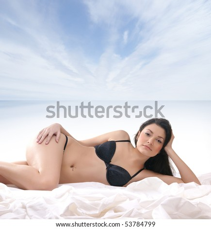 Young sexy brunette on the beach - stock photo