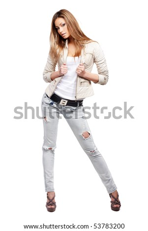 Young sexy brunette woman in white shirt and blue jeans isolated on white - stock photo