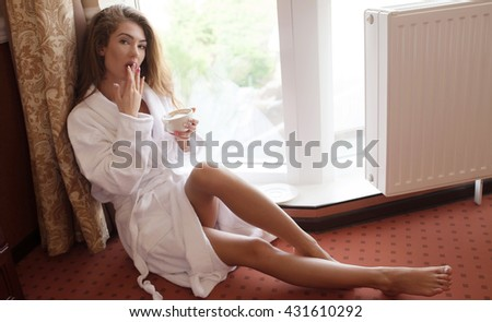 Young sexy brunette woman .Young woman enjoying her morning coffee. - stock photo