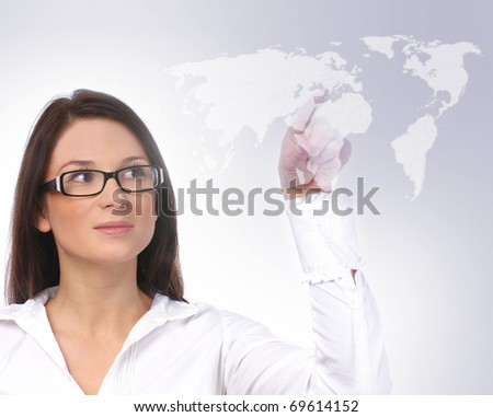 Young sexy business woman with a world map
