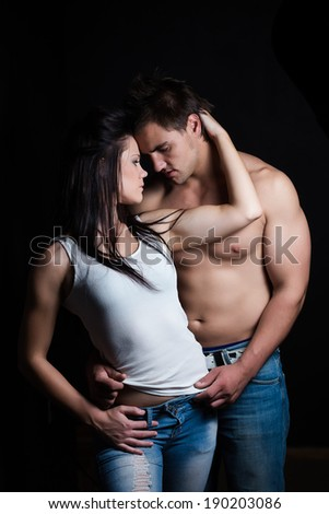 Young sexy caucasian couple in a steamy embrace