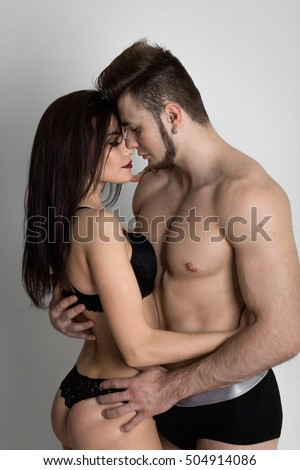Young sexy couple kissing prelude to sex