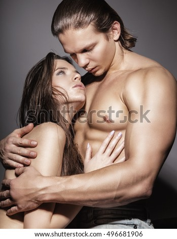 Young sexy couple on a dark background