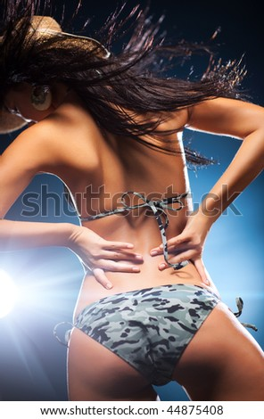 Young sexy dancing woman. Shallow dof effect. - stock photo