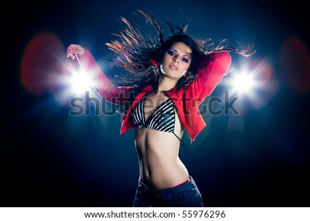 Young sexy dancing woman, with flashes on background - stock photo