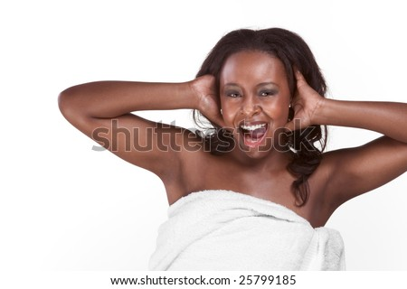 Young sexy emotional gorgeous black African American female in wrapped in bathtowel and screaming - stock photo