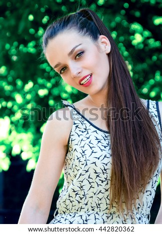 Young sexy female model outdoor portrait. Sensual calm lady with long brown hair seductive lips and lovely eyes - stock photo