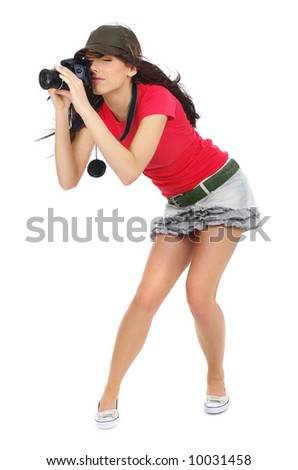 Young sexy girl holding a photo camera. Isolated over white background