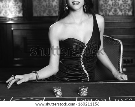 Young sexy girl in casino - stock photo