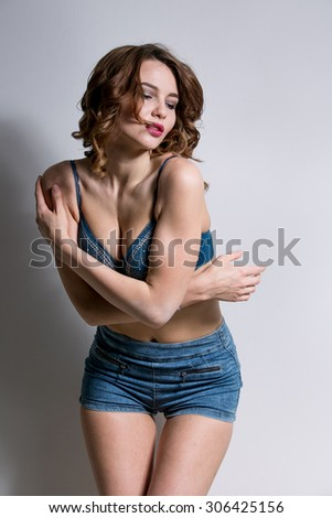 young sexy girl in denim shorts and bra - stock photo