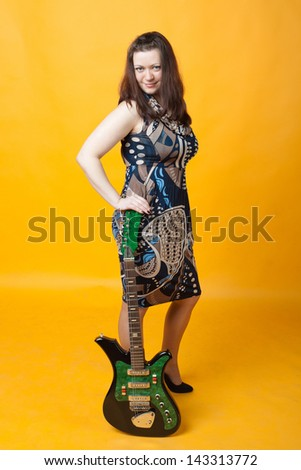 young sexy girl staying with electric guitar - stock photo