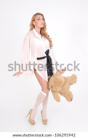 Young sexy girl with teddy bear is shy - stock photo