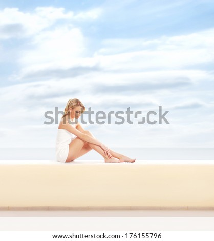 Young, sexy, healthy and beautiful girl in white towel have a vacation on a tourist spa resort - stock photo