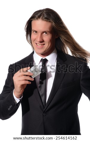 Young sexy man holding condom in hand