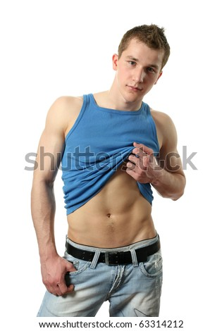 Young sexy man in a blue tank top showing his abs isolated on white - stock photo
