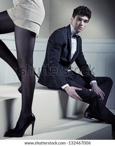 Young sexy man looking at sexy legs - stock photo