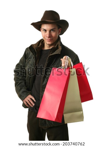 Young sexy man wearing winter clothes with copy space shopping bags isolated on white - stock photo