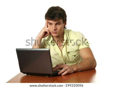 Young sexy man working with a laptop isolated on white - stock photo