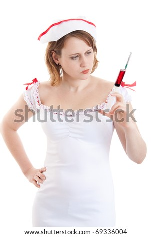 Young sexy nurse with a disposable syringe - stock photo