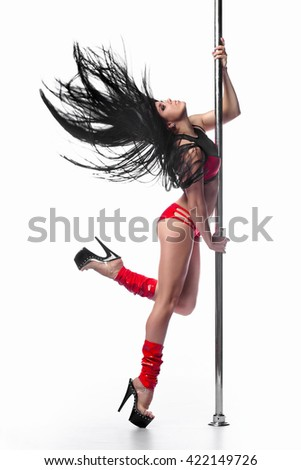 Young sexy pole dance woman dancer dancing isolated on white background - stock photo