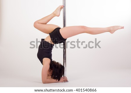 Young sexy pole dancer on white background - stock photo