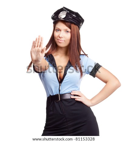 young sexy policewoman, telling us to stop, isolated against white background - stock photo