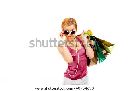 Young sexy shopping girl with lots of colourfull bags. isolated an white background. copy-space - stock photo