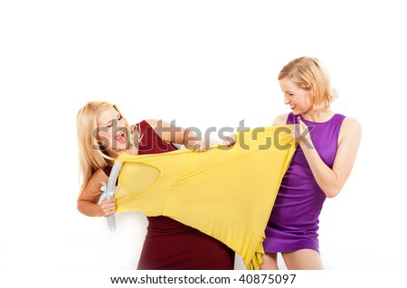 Young sexy shopping woman fighting for a dress. isolated on white background - stock photo