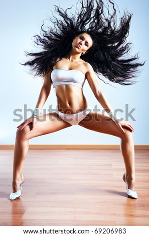 Young sexy slim woman shaking hair. - stock photo