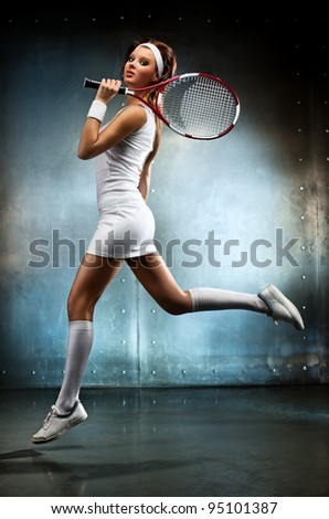 Young sexy tennis player woman running. - stock photo