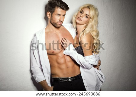 Young sexy undress couple - stock photo