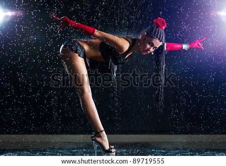 Young sexy woman dancer with water. - stock photo