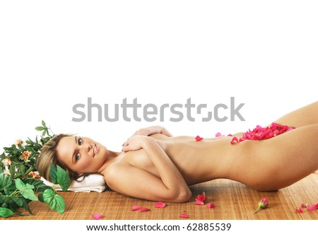 Young sexy woman getting spa treatment isolated on white background