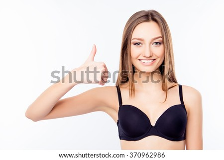 Young sexy woman in black bra thumbs up - stock photo