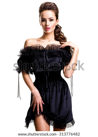Young sexy woman in black dress posing at studio on white background - stock photo