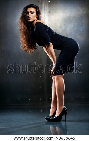 Young sexy woman in elegant clothing. - stock photo