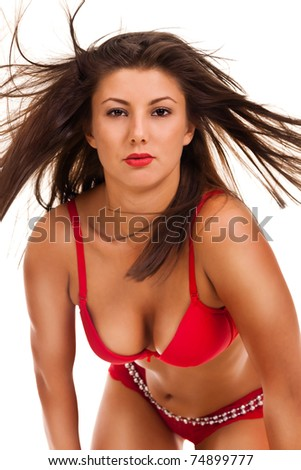 Young sexy woman in lingerie with hair flying on white background - stock photo