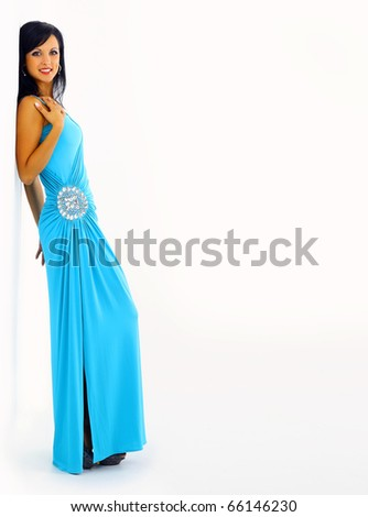 Young sexy woman in stylish blue dress isolated - stock photo