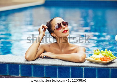 Young sexy woman in the pool - stock photo
