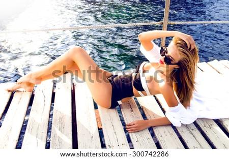 Young sexy woman laying,relaxed near pool at beach wear,polyester,bandage swimsuit sexy monokini,a cutout swimsuit,high waist Bandeau bikini set sexy swimsuit,Pin Up High-waist bikini set two hip-hop - stock photo