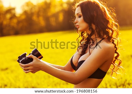 Young sexy woman making self portrait. - stock photo